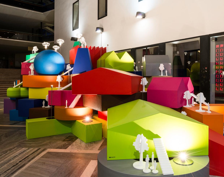 Mvrdv vertical village sculpture at the salone 2014 milan for Milan news mobile